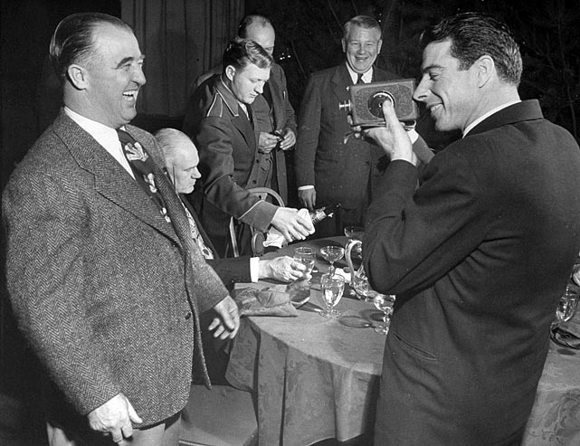 DiMaggio takes a photo of Albert B. Hoppy Chandler at the Banquet of Sports Champions.