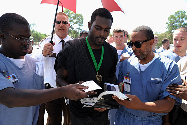 After his speech, Vick spent time signing autographs and answering questions from the men.