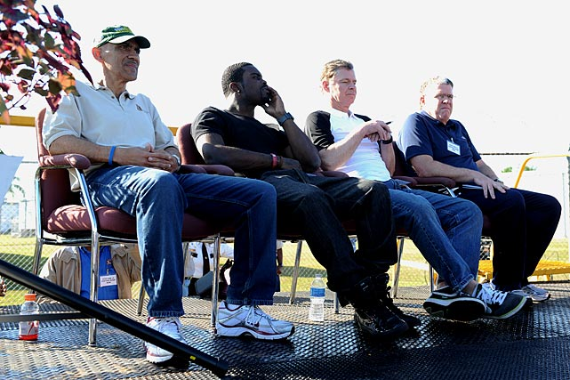 On March 19, (from left) former NFL coach Tony Dungy, Eagles quarterback Michael Vick, radio host Dan Patrick and SI.com's Peter King traveled to Avon Park Correctional Facility in Florida to talk to inmates.
