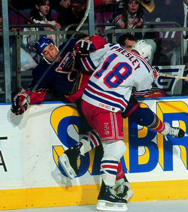The older brother of Russ Courtnall, Geoff was a speedy playmaker with a physical streak who was undrafted but signed by the Bruins in 1983. He went on to score 799 points in 1,048 games during 17 seasons in the NHL, a career that included winning the Stanley Cup with the Oilers in 1988. While skating for the Blues, he was severely concussed in a game against the Sharks on November 27, 1998, but returned in time for the playoffs. Risking permanent injury, he decided to play another season. An unpenalized elbow to the chin by Bryan Berard of the Maple Leafs in October 1999 produced a Grade 2 concussion (on a scale of 3) that ended Courtnall's career.  (Berard was suspended two games for the hit.)