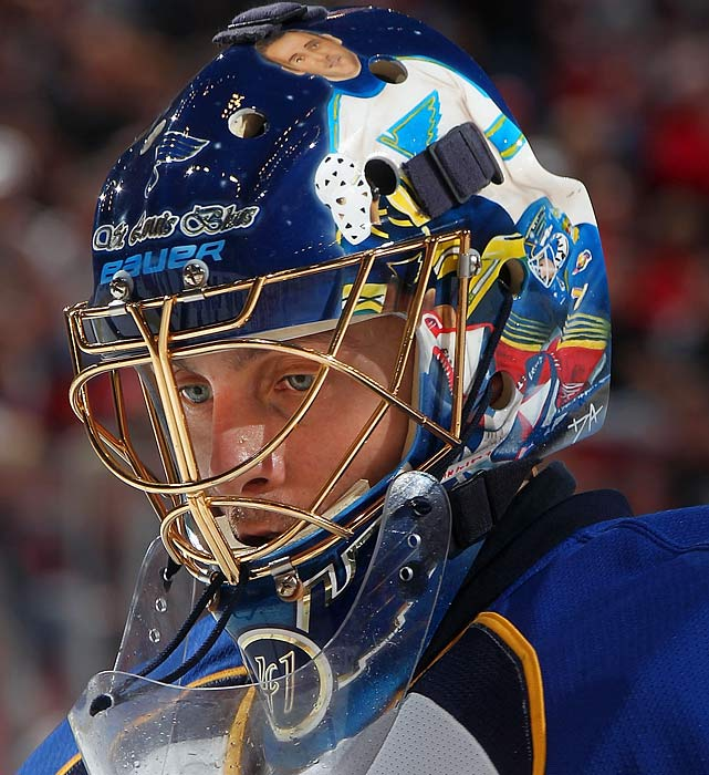 "After St. Louis traded for Halak and signed him to a four-year contract, the Slovakian netminder had a mask designed for home games that included a few Blues goalies of note -- (top to bottom) Jacques Plante, Mike Liut and Grant Fuhr. Was it too soon to add Curtis ""Cujo"" Joseph?"