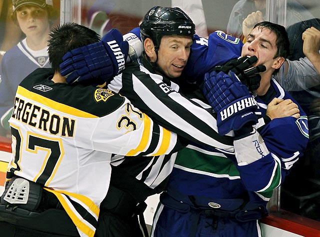 "During a scrum at the end of the first period, Canucks winger Alex Burrows appeared to bite the finger of Bruins center Patrice Bergeron. The NHL later declined to suspend Burrows after reviewing the incident and finding ""no conclusive evidence"" of the bite, although Bergeron was seen wearing a bandage on his finger after the game. But a fuse was lit, and after Burrows scored two goals, including the winner, in Game 2, Max Lapierre of the Canucks taunted Bergeron by waving fingers in his face. It was a gesture the Bruins used during their 8-1 rout of Vancouver in a heated Game 3."