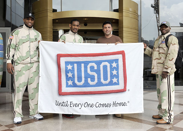 "De La Hoya (second from right) poses with (left to right) Seth Mitchell, Daniel Jacobs and Adrien Broner during their USO tour. ""As a professional boxer I know what it's like to have your mind and body pushed to the limit, and can relate to how our troops must feel,"" De La Hoya said. ""The difference is when they are out here fighting for us, they don't get a break between rounds or to rest between fights, as they are on call and ready to defend our country at a moment's notice. This USO tour is an eye-opening and very humbling experience for me. I can't believe what sacrifices these guys are making and I only hope they know how much I appreciate their service."""