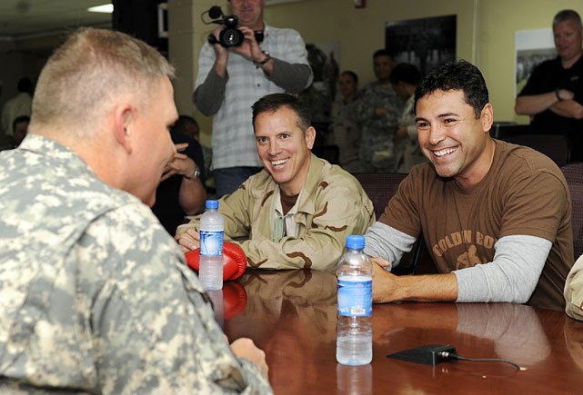 De La Hoya (right) and Robert Gasparri (center) share a laugh with U.S. Army LTC Mark Crumpton, the Deputy Garrison Commander, Area Support Group at Camp Arifjan, Kuwait.
