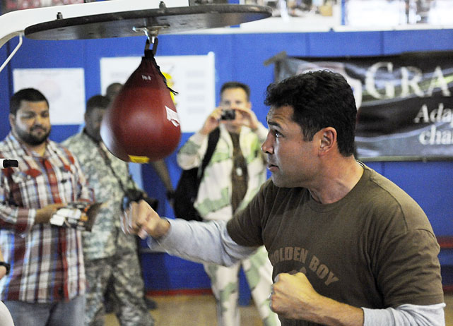 De La Hoya uses the speed bag while taping a public service announcement for U.S. troops serving in the Middle East.