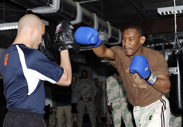 Top middleweight prospect Danny Jacobs (right) lands a blow to the glove of SPC Juan Morel (left) of Providence, R.I., while touring an undisclosed military base in Kuwait on Friday.