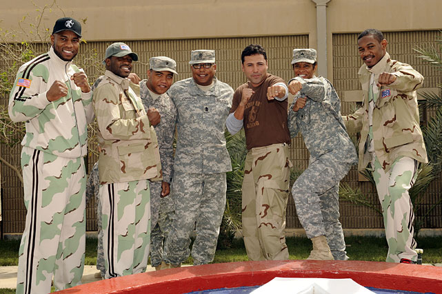 Olympic gold medalist and 10-time world champion Oscar De La Hoya is currently participating in his first USO tour to the Middle East. On Thursday, De La Hoya (third from right) visited with U.S. soldiers from Area Support Group at Camp Arifjan, Kuwait. He was joined by three boxers from his Golden Boy Promotions stable (left to right): Seth Mitchell, Adrien Broner and Danny Jacobs (far right).