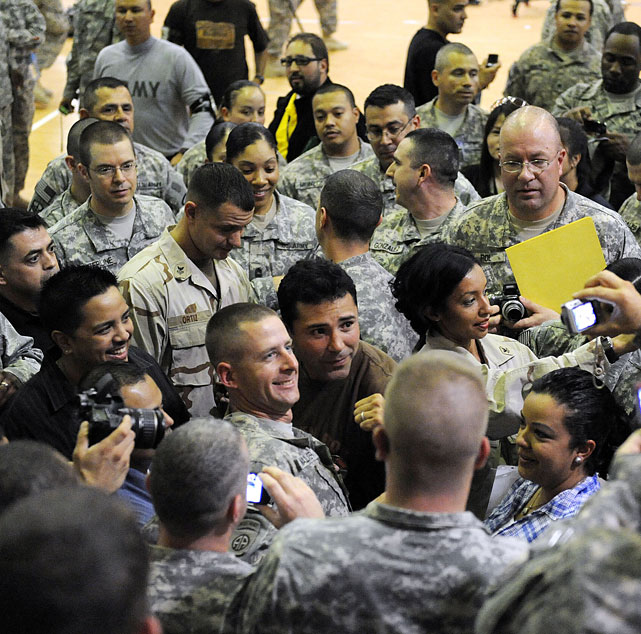 De La Hoya poses for photos with U.S. troops and signs autographs.