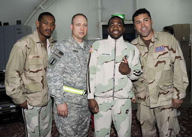 De La Hoya (right) poses for a photograph with the Major Larry Kniffin of Camp Patriot at an undisclosed miltiary base in Kuwait on Friday.