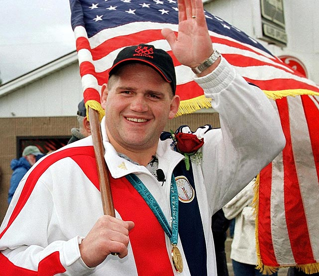 Gardner waves to his hometown crowd as he walks down Main Street in Afton, Wyo., following his upset of Russia's Alexander Karelin in the 2000 Olympics.