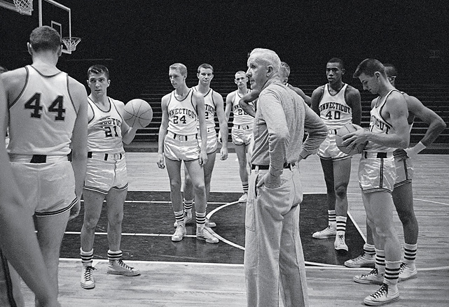 Hugh Greer coached the Huskies from 1947 to 1963, winning 12 Yankee Conference Championships. His most famous victory occurred in 1954, when he led UConn to a one-point victory over Holy Cross, ending the Crusaders' 47-game home-winning streak. He left Storrs with a 286-112 career record.