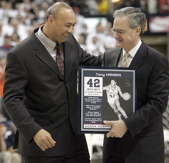 Tony Hanson was the New England Player of the Year in 1977. He led the Huskies to a Sweet 16 appearance in 1976 and closed out his UConn career by averaging a double-double (26 points, 10.6 rebounds per game) as a senior. In this photo, Hanson is honored by UConn Director of Athletics Jeff Hathaway.