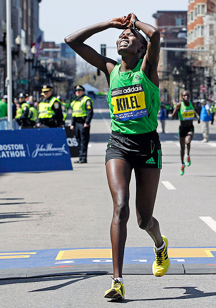 Caroline Kilel is overcome by emotion and exhaustion shortly after winning the women's division of the 115th Boston Marathon.