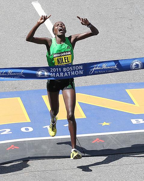 Kenya's Caroline Kilel celebrates winning the women's division of the 115th Boston Marathon.