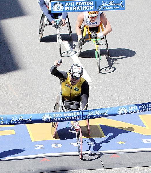Japan's Masazumi Soejima crosses the finish line to win the men's wheelchair division of the 115th Boston Marathon.