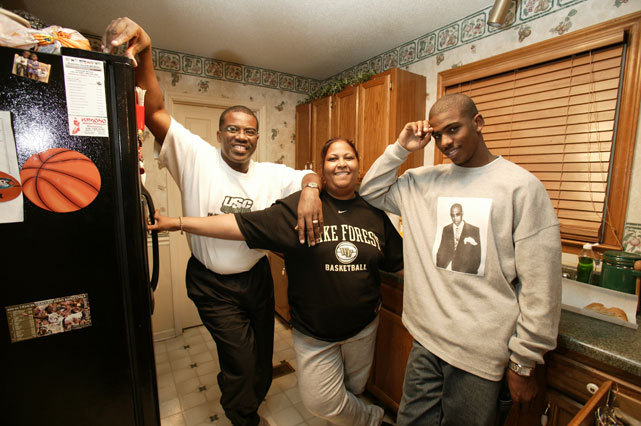 Paul, donning a Jay-Z sweatshirt, is all smiles with his ma, Robin Jones and pa, Charles Paul.