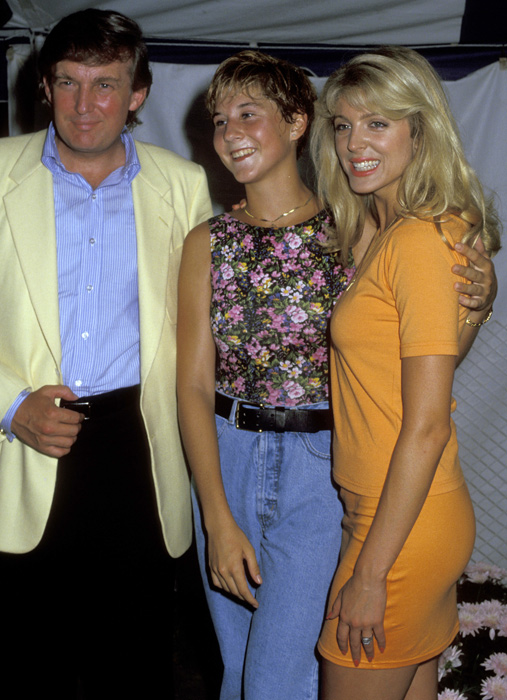 Trump with tennis star Monica Seles and actress Marla Maples in July 1991. Seles won three majors (Australian, French and U.S. Opens) in 1991 but was unable to compete at Wimbledon because of shin splints.