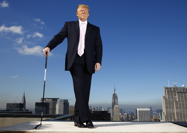 Trump poses with a golf club during a 2010 photo shoot on the roof of Trump Tower. He owns 11 golf courses, including ones in Scotland and Puerto Rico.