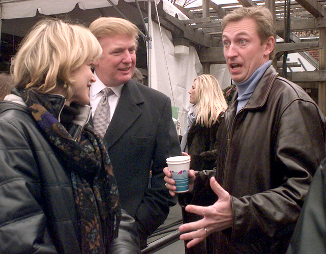 "Wayne Gretzky and his wife, Janet, talk to Trump in Central Park. Trump and The Great One both served on the judges' panel for a spoken essay contest called ""Most Gripping Moment of My Life."""