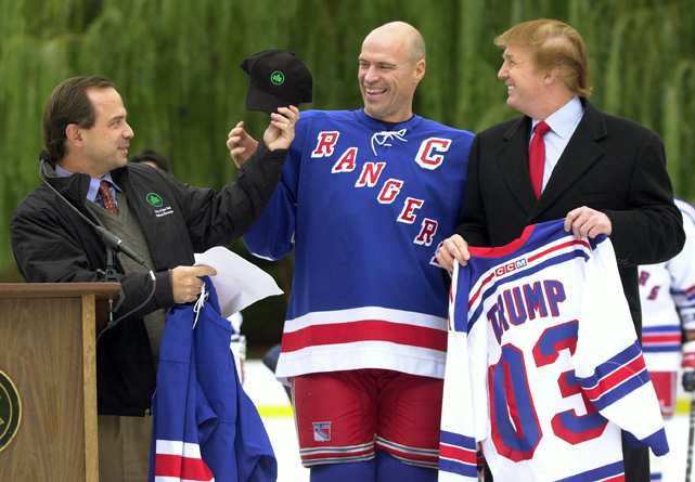 Trump holds a personalized jersey as Rangers' captain Mark Messier receives a hat from Parks Commissioner Adrian Benepe during a special practice session in  Central Park. Messier retired at the end of the season.