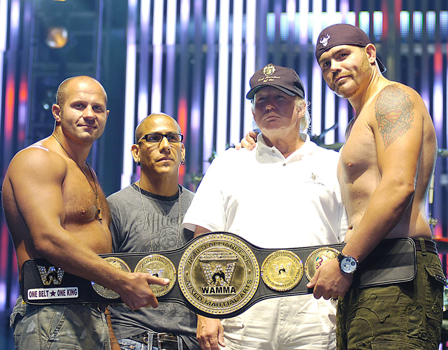 Trump and mixed martial arts star Tim Sylvia pose during the weigh-in for the Affliction: Banned MMA event in July 2008 in Anaheim, Calif.