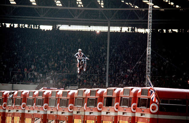 The daredevil clears 13 buses on his motorcycle at a show in 1975 at Wembley Stadium in London.