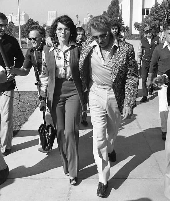 Knievel leaves a California courthouse in 1977 with his then-wife Linda after he was sentenced to six months in jail and three years probation for beating promoter Shelly Saltman with a baseball bat. The dispute allegedly occurred because Saltman's book painted the daredevil in a bad light, accusing him of beating his wife and abusing drugs.
