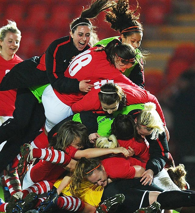 Welsh players celebrate following their under-19 women's international friendly against Germany on March 31.