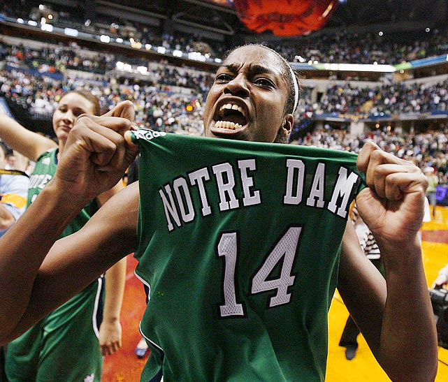 Notre Dame guard Devereaux Peters proudly displays her alma mater after the Fighting Irish upset the UConn Huskies in the semifinals of the women's Final Four.