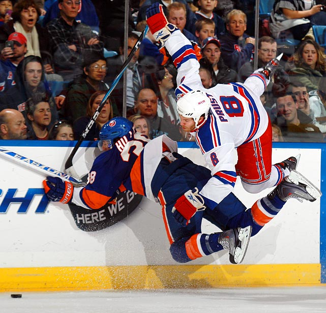 New York Islanders defenseman Jack Hillen and New York Rangers leftwinger Brandon Prust engage in a  Matrix -like fight for the puck during the Islanders 6-2 victory.