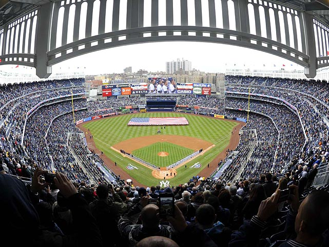 Crowds braved the cold and rain as the 2011 major league baseball season kicked off at Yankee Stadium on March 31.