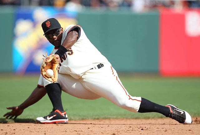 San Francisco Giants shortstop Miguel Tejada, 36, looks ageless as he backhands a one-hopper during the Giants' 5-4 win over the St. Louis Cardinals.