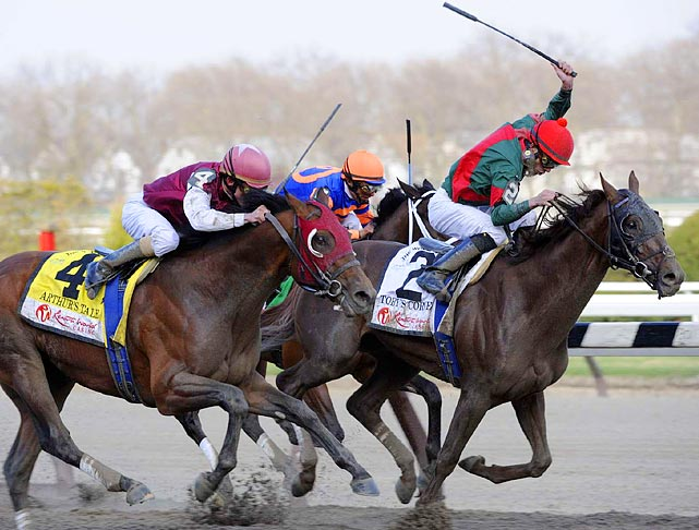 Eddie Castro and his horse Toby's Corner (right) shock the field by winning the Wood Memorial over Kentucky Derby favorite Uncle Mo.