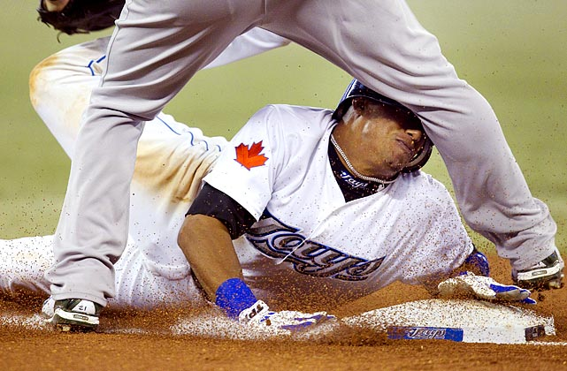 Toronto Blue Jays shortstop Yunel Escobar gets a face full on a hard slide into third during the Blue Jays' 5-3 win over the Athletics.  At least he was safe.