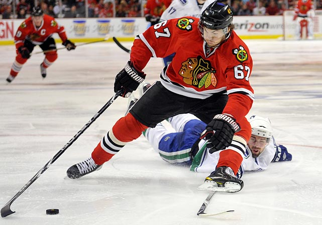The Vancouver Canucks led 3-2 in the third quarter of Game 6 of the Western Conference quarterfinals before Canucks defenseman Dan Hamhuis (bottom) tripped Chicago Blackhawks center Michael Frolik (center). Frolik promptly converted the penalty shot, and the Blackhawks went on to win in overtime to force a Game 7.