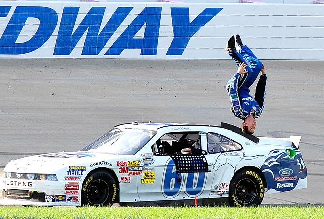 Carl Edwards celebrates with his trademark backflip after winning the Nashville 300 at Nashville Superspeedway on April 23.