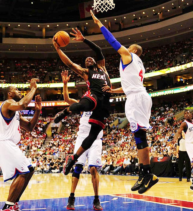 Miami Heat guard Dwyane Wade slices his way through the Philadelphia 76ers' defense during the Heat's 86-82 defeat in Philadelphia in Game 4 of the Eastern Conference quarterfinals.