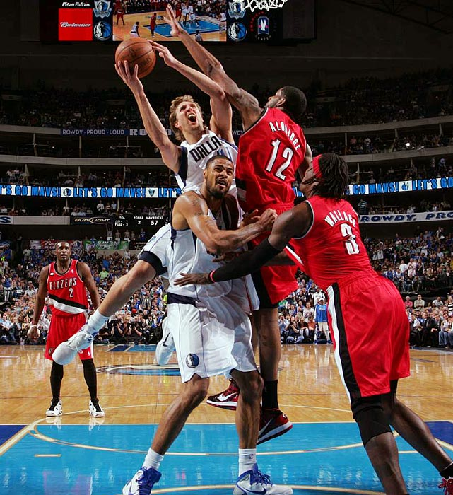 Dirk Nowitzki (top left) goes over the back of teammate Tyson Chandler for a layup during Game 1 of the Trail Blazers-Mavericks game in the first round of the NBA playoffs. Nowitzki would score 28 points during the Mavericks' 89-81 victory.