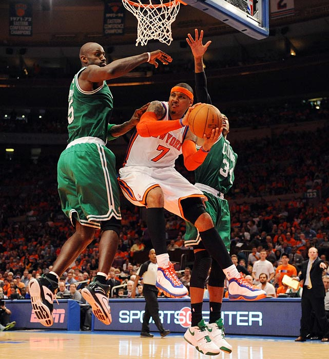 Carmelo Anthony (center) looks for someone to dish the ball to during the Knicks' 101-89 loss to the Celtics in Game 4 of the Eastern Conference quarterfinals.  Anthony would finish the series-clinching game with 32 points and three assists.