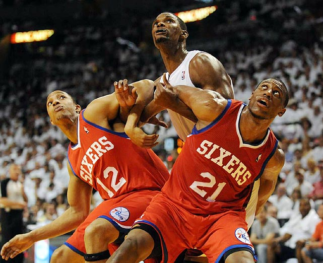Evan Turner (left) and Thaddeus Young (right) did their best to stop Chris Bosh, but the Miami Heat power forward dominated Game 1 of the Eastern Conference quarterfinals. Bosh recorded 25 points and 12 rebounds as the Heat defeated the 76ers 97-89.