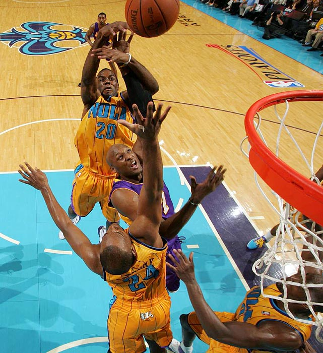Taking advantage of a battered Hornets' frontcourt, Lamar Odom (center) and Andrew Bynum combined for 44 points and 30 rebounds as the Lakers downed the Hornets 100-86 in Game 3 of the Western Conference quarterfinals.