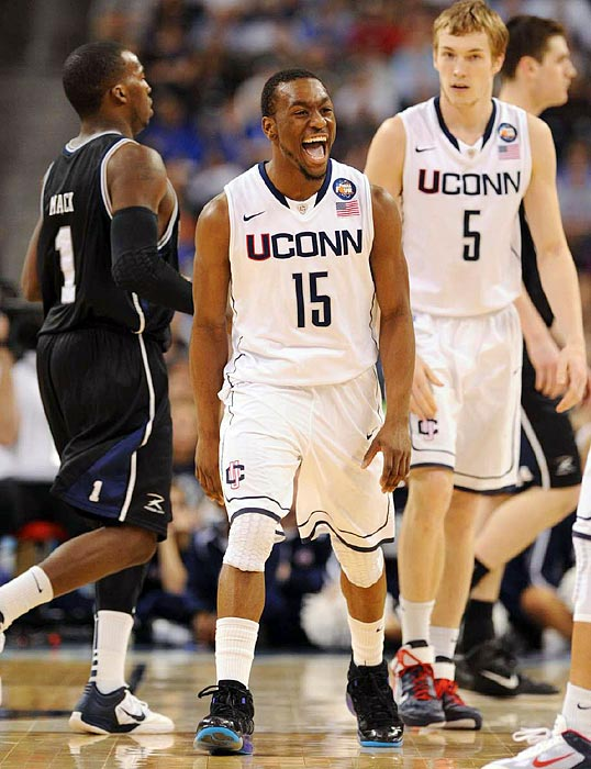 UConn guard Kemba Walker, who scored a game-high 16 points and was the tournament's Most Outstanding Player, celebrates in the closing minutes of the Huskies' win.