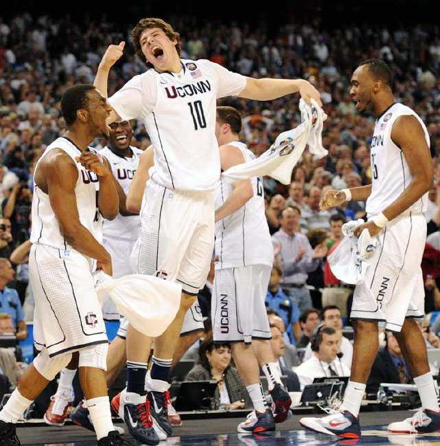 Players on UConn's bench celebrate as the final buzzer sounds, giving them a 12-point victory over Butler in the championship game.