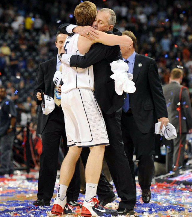 UConn freshman Niels Giffey embraces Jim Calhoun following the team's win.