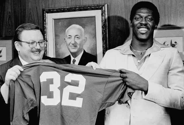 The Cardinals' first-round pick holds up his jersey alongside owner William Bidwell. The running back won Rookie of Year in 1979 and made the Pro Bowl in his first two seasons. He later added the 1991 Super Bowl MVP award for his performance in the Giants' win over the Bills.