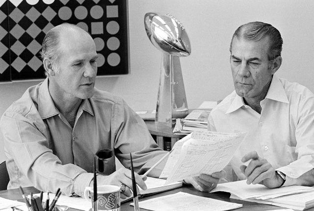 The Hall of Fame coach and special assistant Ermal Allen go through scouting reports before the draft. The Cowboys won the Super Bowl trophy a few days before this picture was taken, thanks in part to their draft success.