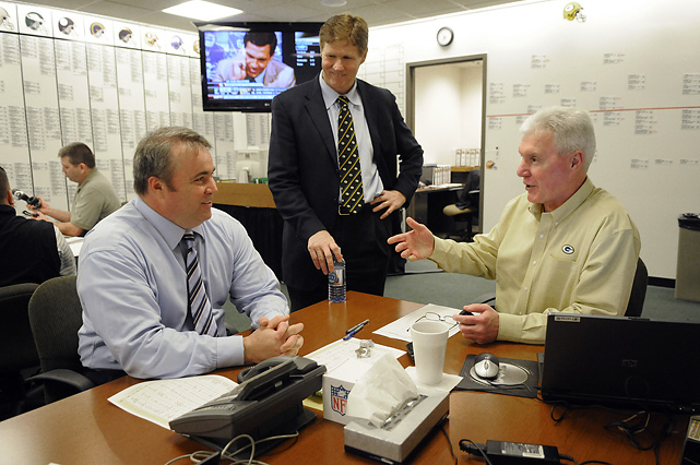 Green Bay Packers general manager Ted Thompson (right) talks to head coach Mike McCarthy (left) and president Mark Murphy at Lambeau Stadium.