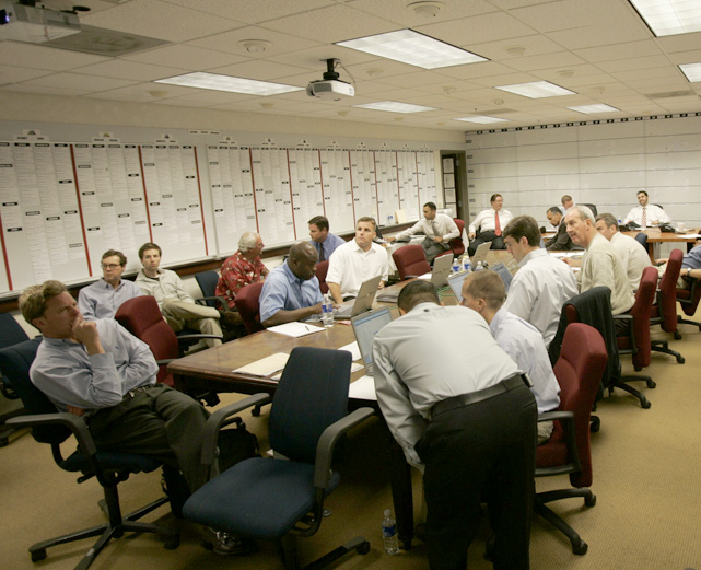The San Francisco 49ers study their notes before taking Patrick Willis with the 11th overall pick.