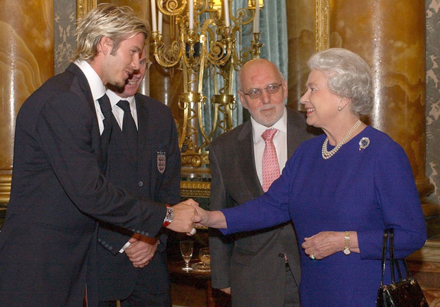 Queen Elizabeth II meets England captain David Beckham and manager Sven Goran Eriksson (2nd left) during a reception for the Football Association held a Buckingham Palace.