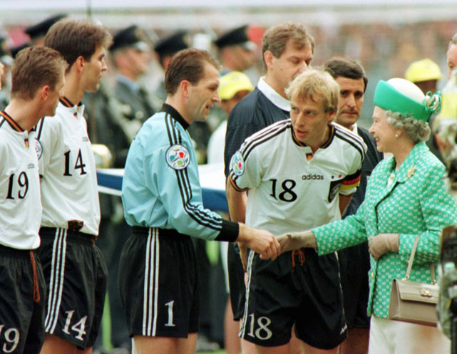 Queen Elizabeth II is introduced to the German soccer team prior to the start of the final of the European Soccer Championships at Wembley Stadium in London. German players are (from right) Jurgen Klinsmann, Andreas Kopke, Markus Babbel and Thomas Strunz.